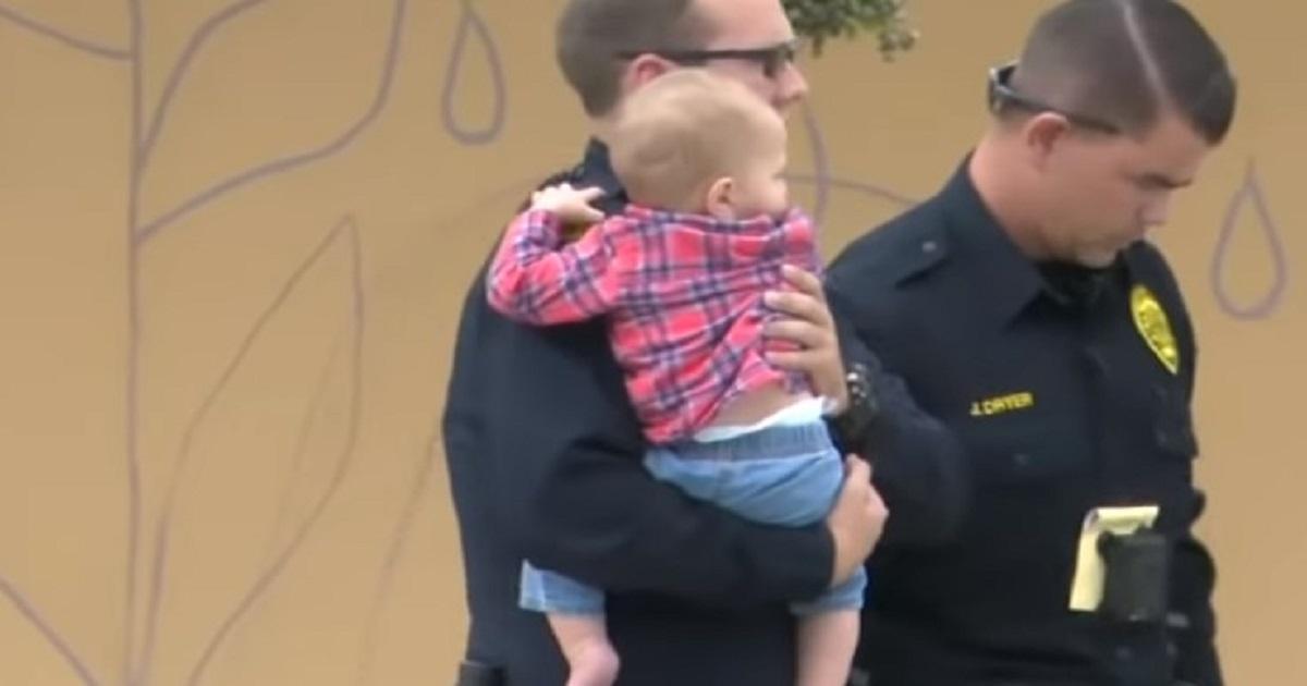 kobieta z bronią i dzieckiem na rękach